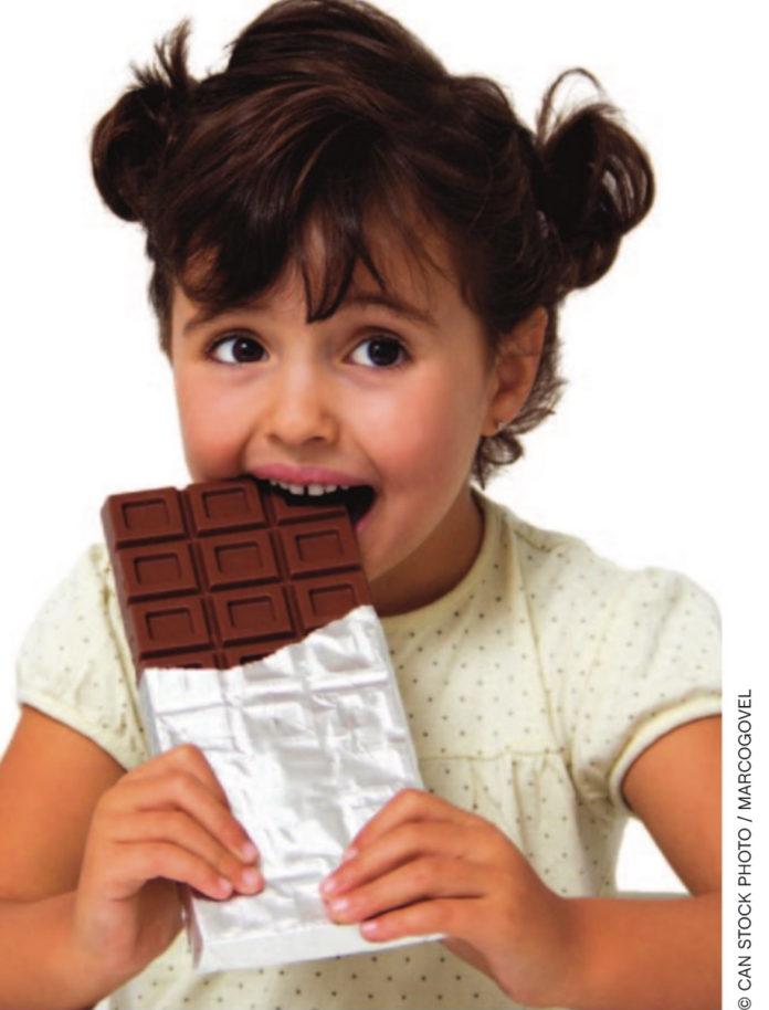 Child with candy stock photo