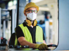 worker with mask stock image
